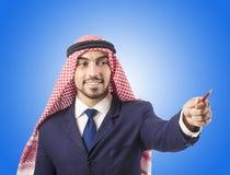 Arab man pressing virtual buttons Royalty Free Stock Photos