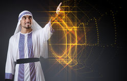 The arab man pressing virtual buttons in futuristic concept Stock Photography