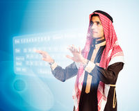 Arab man pressing virtual keybord Stock Photo