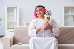 The arab man with prize and money on sofa Stock Photos