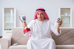 The arab man with prize and money on sofa Royalty Free Stock Photos