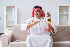 The arab man with prize and money on sofa Stock Image