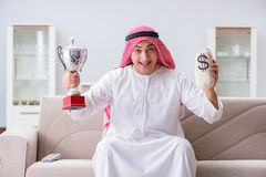 The arab man with prize and money on sofa Royalty Free Stock Images