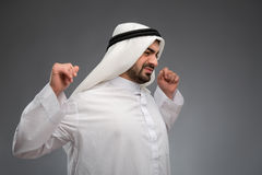 Arab man raising his hands being tired Royalty Free Stock Photography