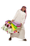 Arab man with shopping bags on white Stock Photos