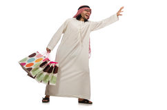 The arab man with shopping bags on white Stock Photos