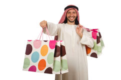 The arab man with shopping bags on white. Arab man with shopping bags on white Royalty Free Stock Image