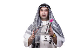 The arab man with shopping cart trolley isolated on white. Arab man with shopping cart trolley isolated on white Royalty Free Stock Images