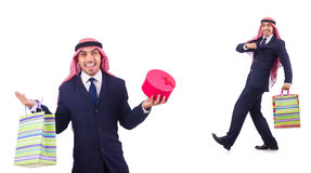The arab man with shopping gifts on white Stock Photos
