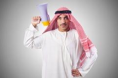 Arab man shouting through loudspeaker Stock Photography