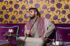 Arab Man Smoking Shisha And Drinking Coffee Stock Photos