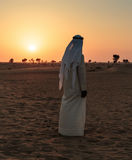 Arab man stands alone in the desert Royalty Free Stock Photos