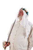 Arab Man with a Sword. Older arab man holding a sword isolated on white Royalty Free Stock Photos