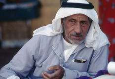 Arab man wearing kaffiyeh in rural Syria. Arab man leaning against pillow in tent in rural Syria during a discussion stock photography
