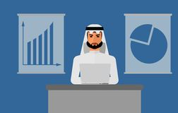 Arab_man_on_the_table_with_computer Image stock