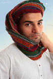 Arab Man in traditional turban keffiyeh. An adult arab middle eastern man dressed in traditional clothing.  He has a keffiyeh turban on his head Stock Images