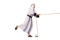 Arab man. In tug of war concept Royalty Free Stock Photo