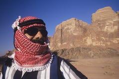 Arab Man In Turban And Sunglasses In Desert Stock Image