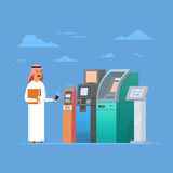 Arab Man Using Atm Machine Cell Smart Phone Mobile Payment, Islam Businessman Wearing Traditional Clothes Stock Image