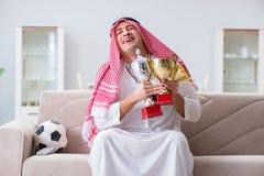 The arab man watching sport football at tv Royalty Free Stock Image