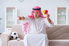 The arab man watching sport football at tv Stock Photo