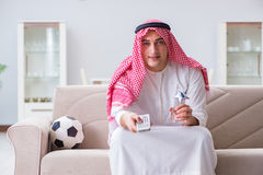 The arab man watching sport football at tv Royalty Free Stock Photo