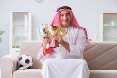The arab man watching sport football at tv Royalty Free Stock Photos