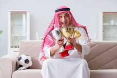 The arab man watching sport football at tv Stock Photography