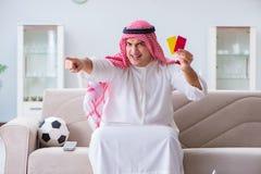The arab man watching sport football at tv Stock Image