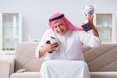 The arab man watching sport football at tv Royalty Free Stock Images