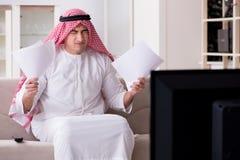The arab man watching tv at home. Arab man watching tv at home Royalty Free Stock Photos