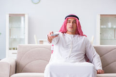 The arab man watching tv at home Royalty Free Stock Image
