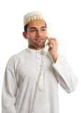 Arab man wearing white robe and topi Stock Photography