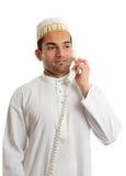 Arab man wearing white robe and topi Stock Photography
