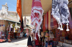 The Arab market of the old city Jerusalem, Israel. Arab keffiyeh on display in a store at the Arab market of the old city Jerusalem, Israel Royalty Free Stock Photos