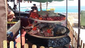Arab Markets Ibiza Spain. Roasted grilled fried braised succulent tender stewed boiled bbq barbecued rotisserie marinaded meats, seafood, octopus, calamari Stock Photography