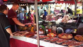 Arab Markets Ibiza Spain. Roasted, grilled, fried, braised, succulent, tender, stewed, boiled, simmered, bbq, barbecued, rotisserie marinaded meats, seafood Stock Image