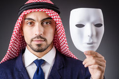 Arab with masks. In dark studio Royalty Free Stock Photography