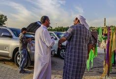 Arab men chatting at rural market royalty free stock photos