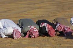 Arab men praying Asr in the desert Royalty Free Stock Image