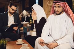 Arab man with wife at psychologist reception. royalty free stock photos
