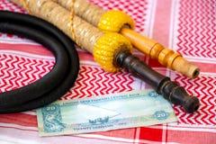 Arab Money Dirham Banknote, hookah and Traditional Arab Male Clothes - kaffiyah and agal  close-up
