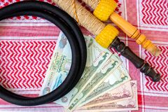 Arab Money Dirham Bank note, , hookah and Traditional Arab Male Clothes - kaffiyah and agal  close-up