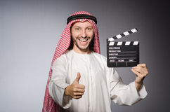Arab with movie Stock Images