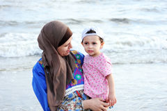 Arab muslim baby girl with her mother Royalty Free Stock Photos