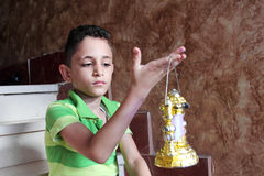 Arab muslim child with ramadan lantern royalty free stock photography