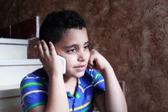 Arab muslim child talking in mobile phone Royalty Free Stock Photography