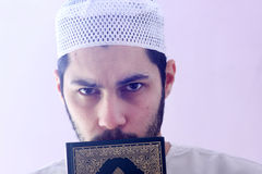 Arab muslim man with koran holy book Stock Photography