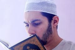 Arab muslim man with koran holy book Royalty Free Stock Photography