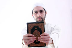 Arab muslim man with koran holy book Stock Images